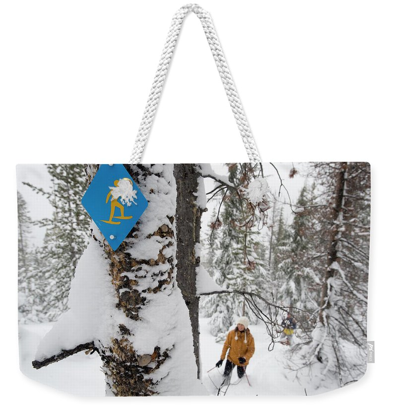30-35-years Weekender Tote Bag featuring the photograph High Angle View Of A Mid Adult Woman by Jonathan Kingston