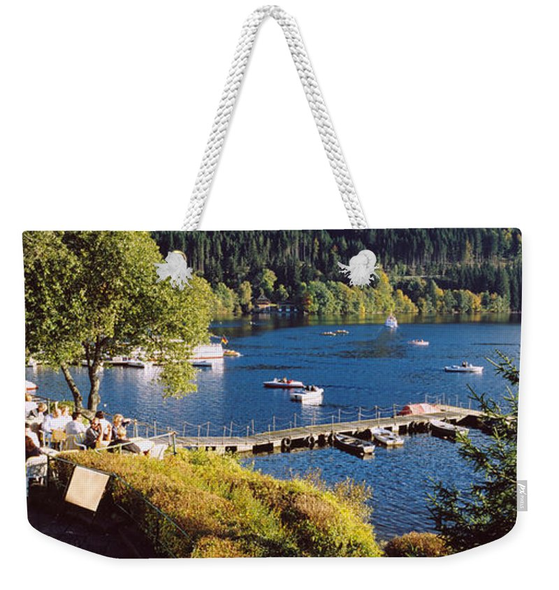Photography Weekender Tote Bag featuring the photograph High Angle View Of A Restaurant Near A by Panoramic Images