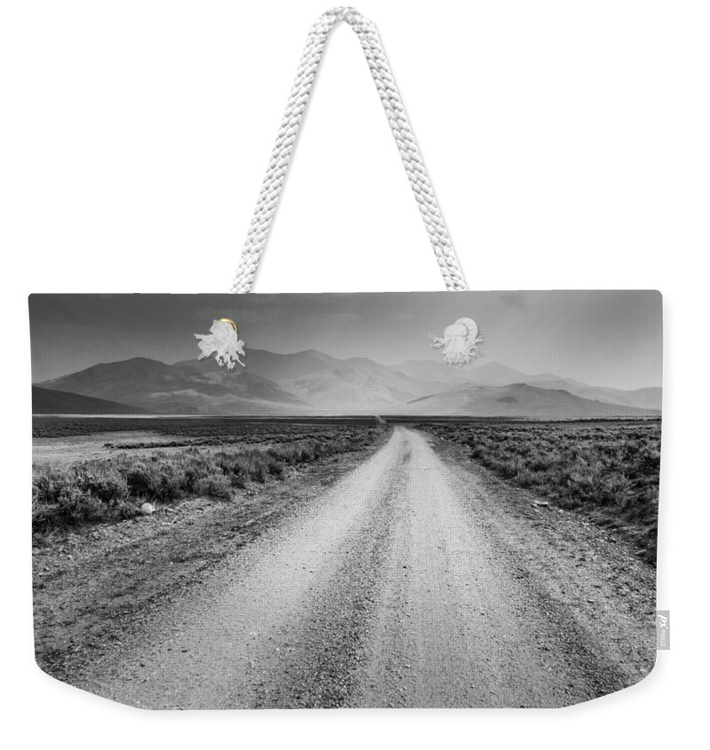 Rebecca's Private Idaho Weekender Tote Bag featuring the photograph Sunbeams On The Mountains by Eric Benjamin