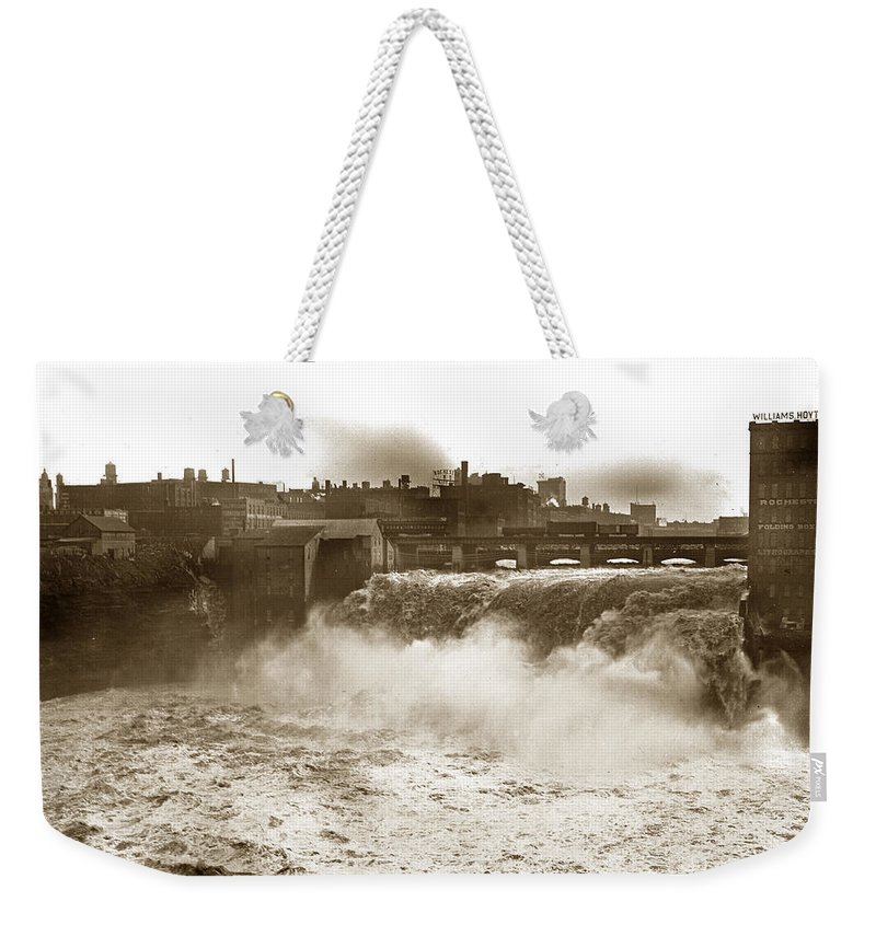Genesee Weekender Tote Bag featuring the photograph High Falls On The Genesee River Rochester New York At Flood Stage Circa 1904 by California Views Archives Mr Pat Hathaway Archives