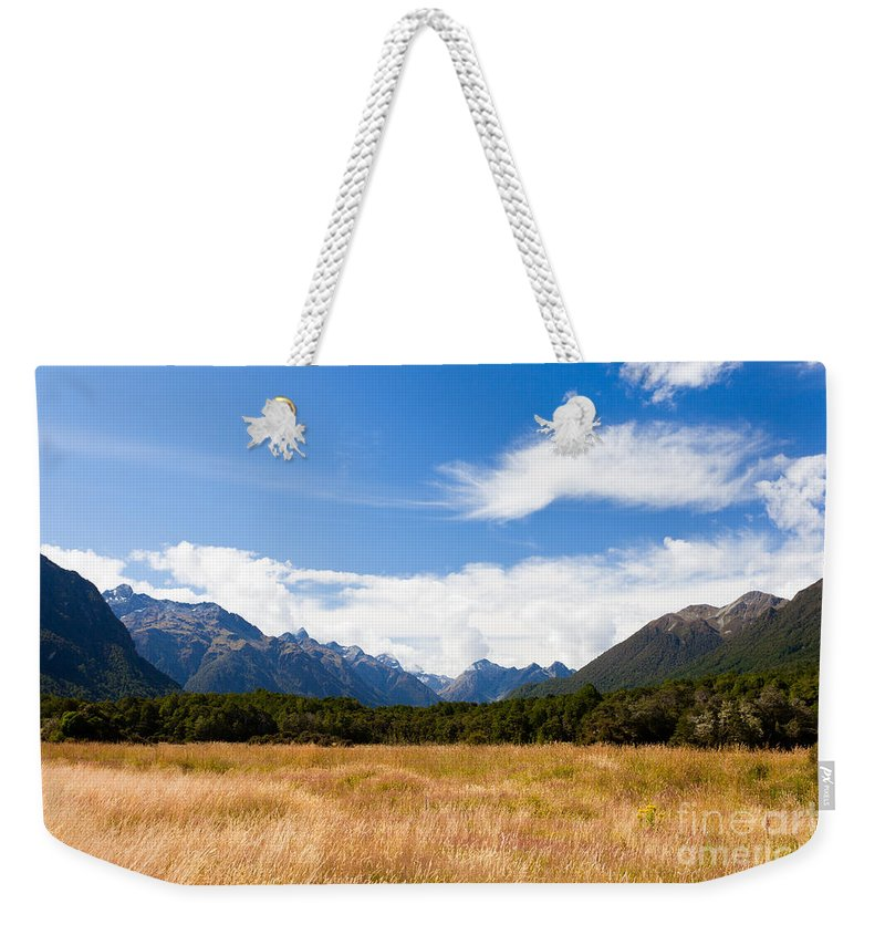 Mount Weekender Tote Bag featuring the photograph High Peaks Of Eglinton Valley In Fjordland Np Nz by Stephan Pietzko