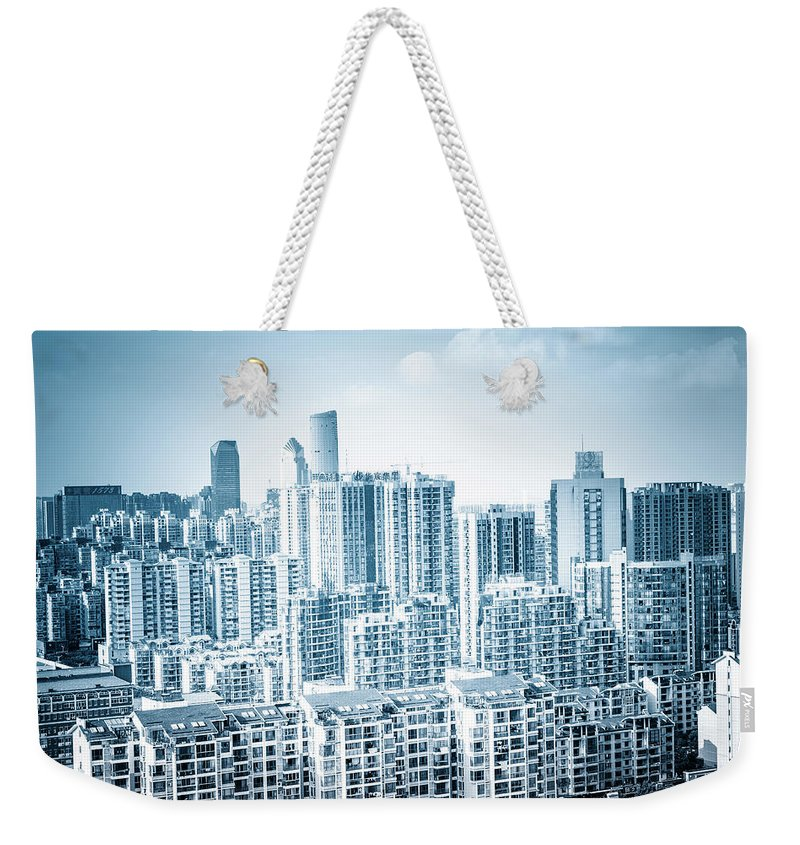 Residential District Weekender Tote Bag featuring the photograph High Rise Residential Area by Aaaaimages