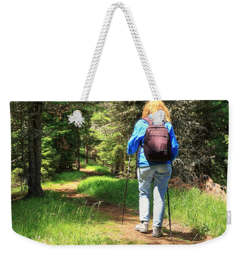 Alps Weekender Tote Bag featuring the photograph Hiker In The Forest by Antonio Scarpi