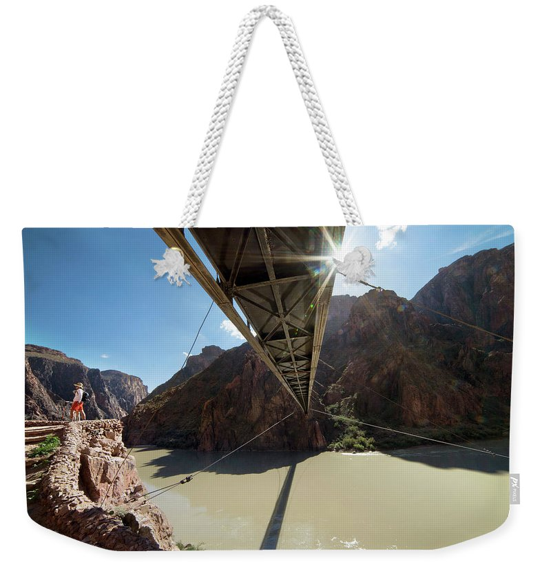 Eroded Weekender Tote Bag featuring the photograph Hikers By Colorado River At Grand by Bennett Barthelemy