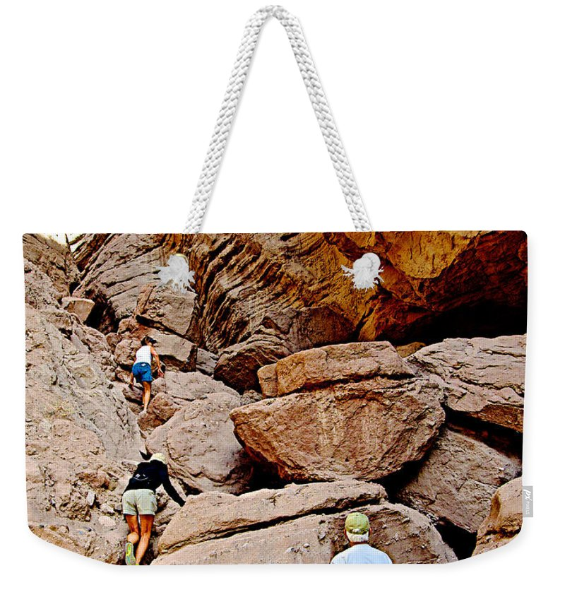 Hikers Enter Ladder Canyon From Big Painted Canyon Trail In Mecca Hills Weekender Tote Bag featuring the photograph Hikers Enter Ladder Canyon From Big Painted Canyons Trail In Mecca Hills-ca by Ruth Hager