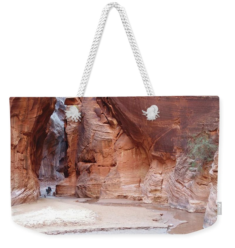Tranquility Weekender Tote Bag featuring the photograph Hikers Entering Buckskin Gulch From by Photograph By Michael Schwab