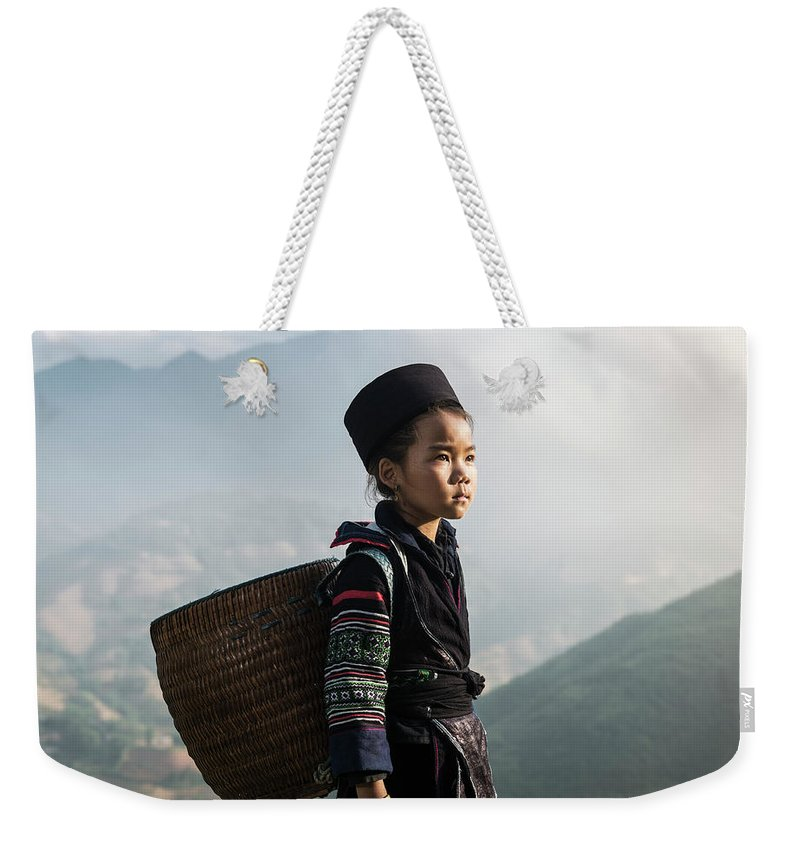 Child Weekender Tote Bag featuring the photograph Hill Tribe Girl Standing On Hill Side by Martin Puddy