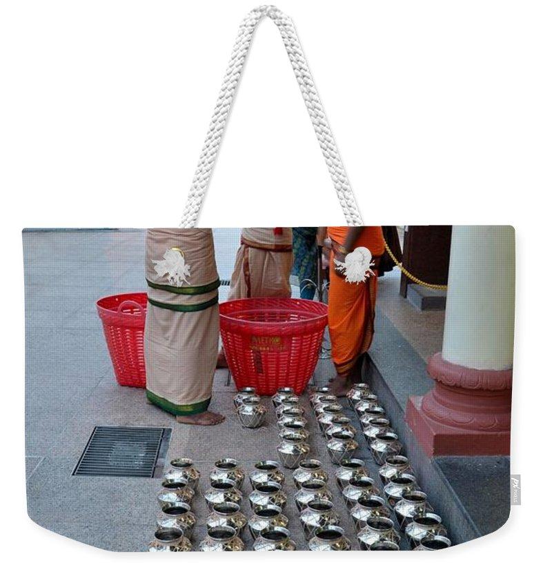 Hindu Weekender Tote Bag featuring the photograph Hindu Priests Prepare Offering To Gods by Imran Ahmed
