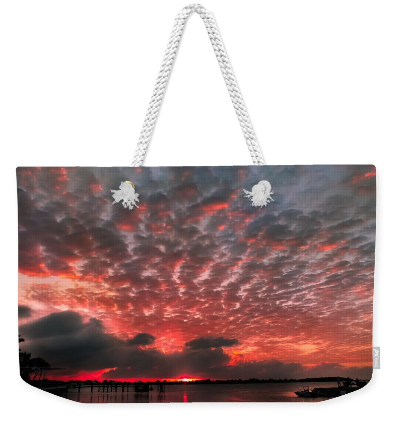 Florida Keys Sunsets Weekender Tote Bag featuring the photograph His Signature by Karen Wiles