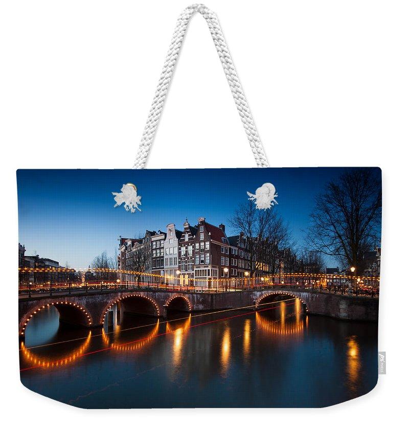 Bridge Weekender Tote Bag featuring the photograph Historic Amsterdam by Wim Slootweg