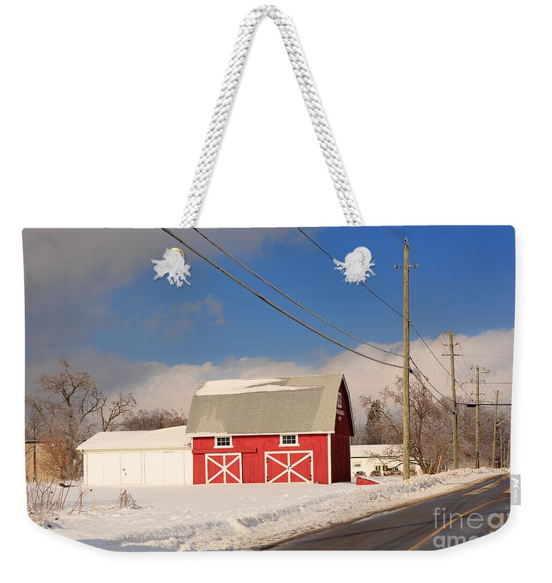 Red Weekender Tote Bag featuring the photograph Historic Red Barn On A Snowy Winter Day by Louise Heusinkveld
