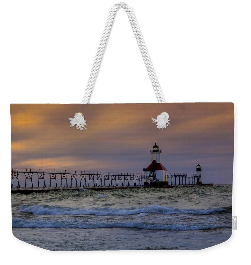 Lake Michigan Weekender Tote Bag featuring the photograph History In Action by Michael J Samuels