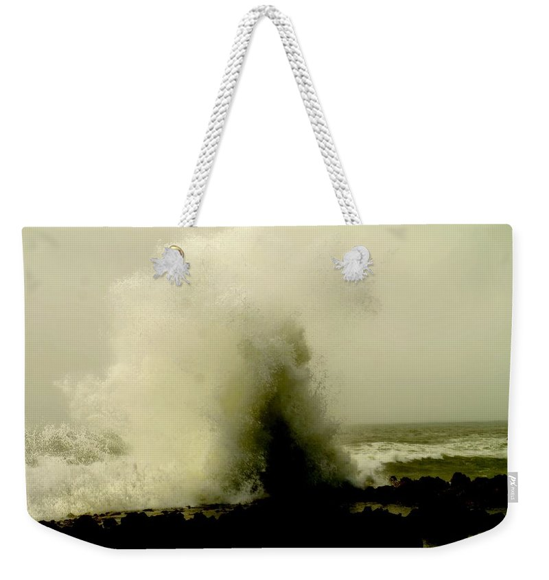 Ocean Weekender Tote Bag featuring the photograph Hitting The Rocks by Jeff Swan