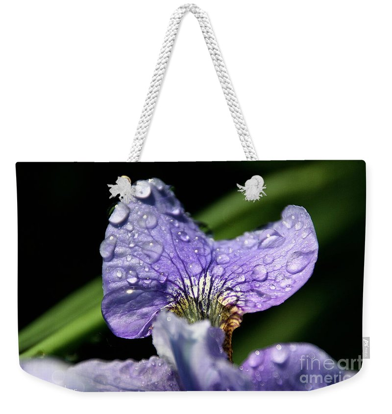 Flower Weekender Tote Bag featuring the photograph Holding by Susan Herber