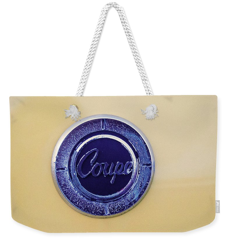 Popular Weekender Tote Bag featuring the photograph Honda Z600 Coupe Medallion by Paulette B Wright