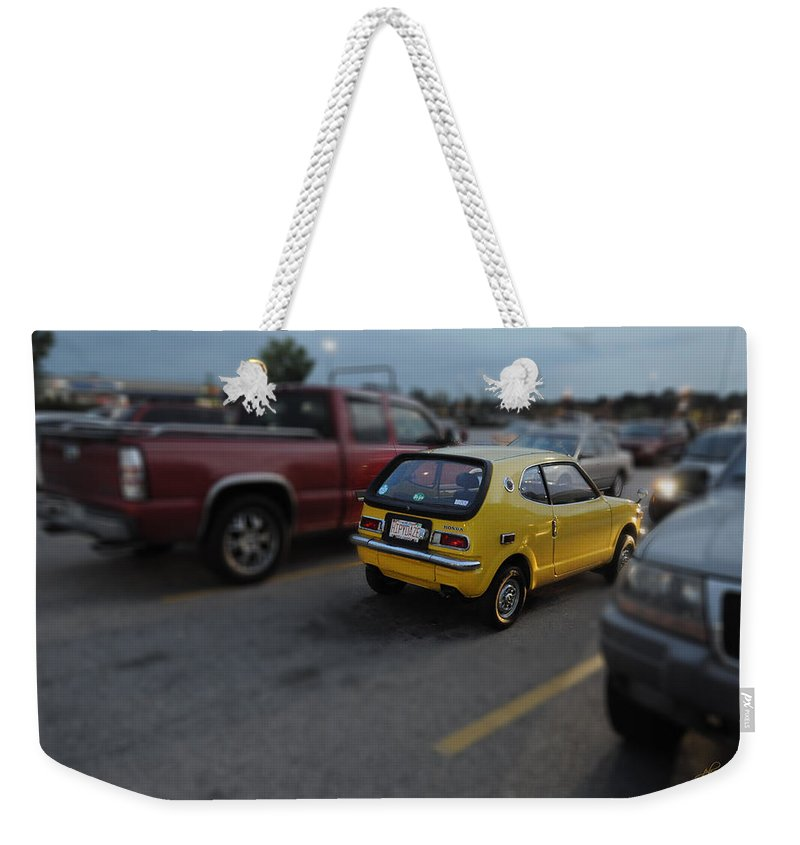 Popular Weekender Tote Bag featuring the photograph Honda Z600 by Paulette B Wright