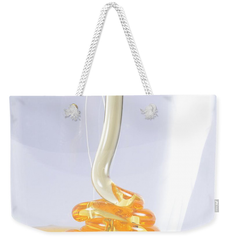 Viscosity Weekender Tote Bag featuring the photograph Honey, Coiling Effect by Photo Researchers, Inc.