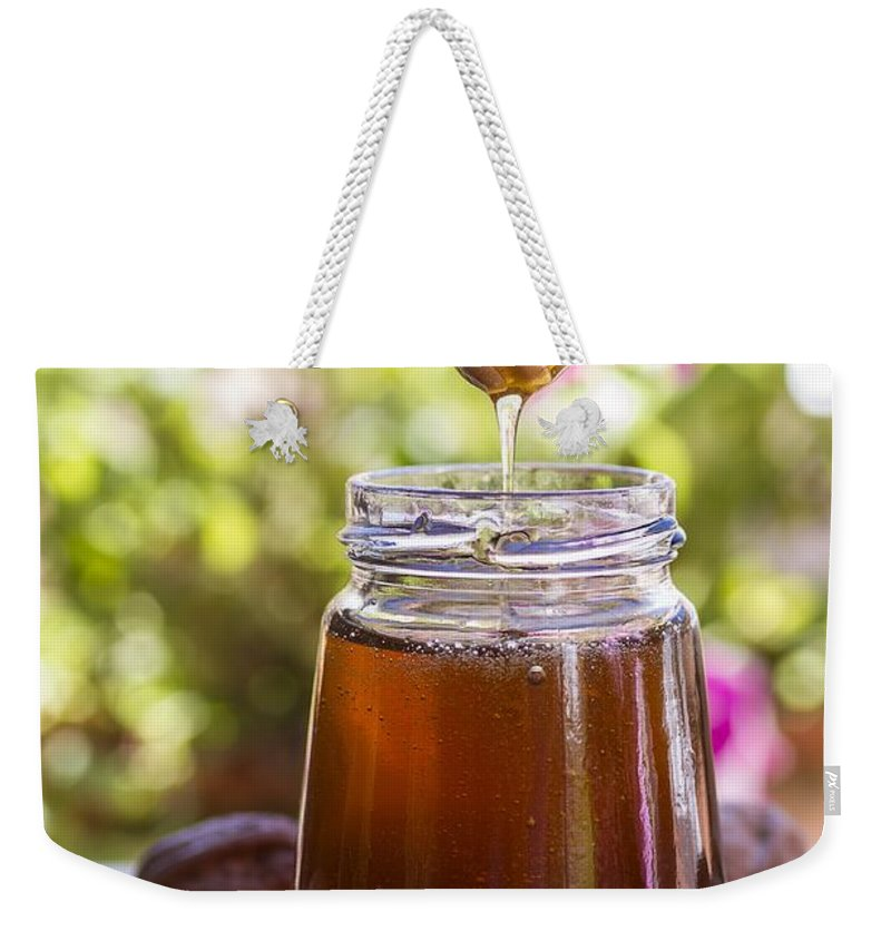 Delicious Weekender Tote Bag featuring the photograph Honey by Paulo Goncalves