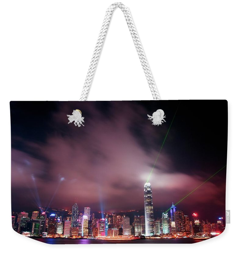 Tranquility Weekender Tote Bag featuring the photograph Hong Kong Laser Lights by Photo By Dan Goldberger