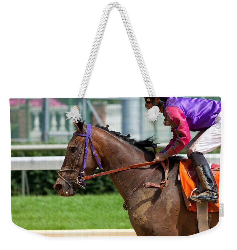 Track Weekender Tote Bag featuring the photograph Horse Racing by Alexey Stiop