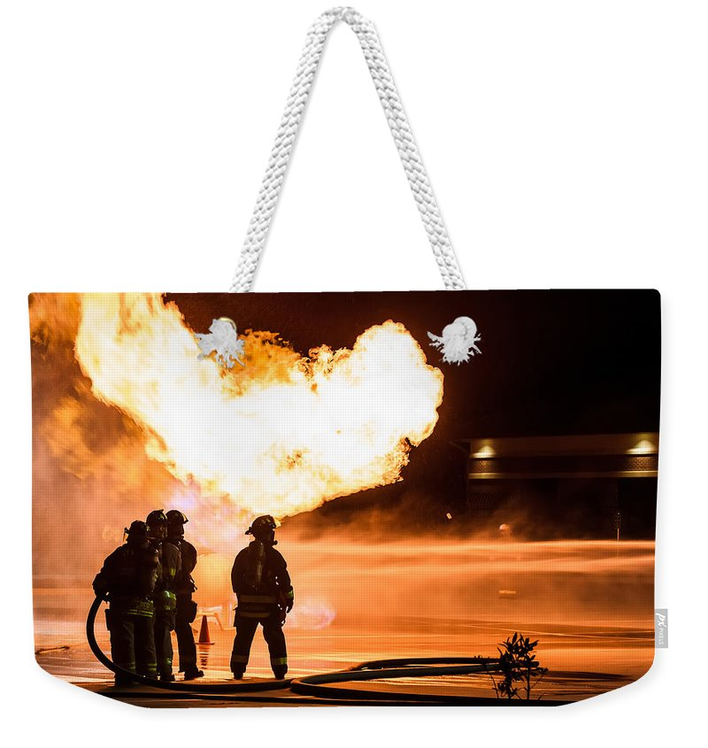 Extinguish Weekender Tote Bag featuring the photograph Hot Flames by Sennie Pierson