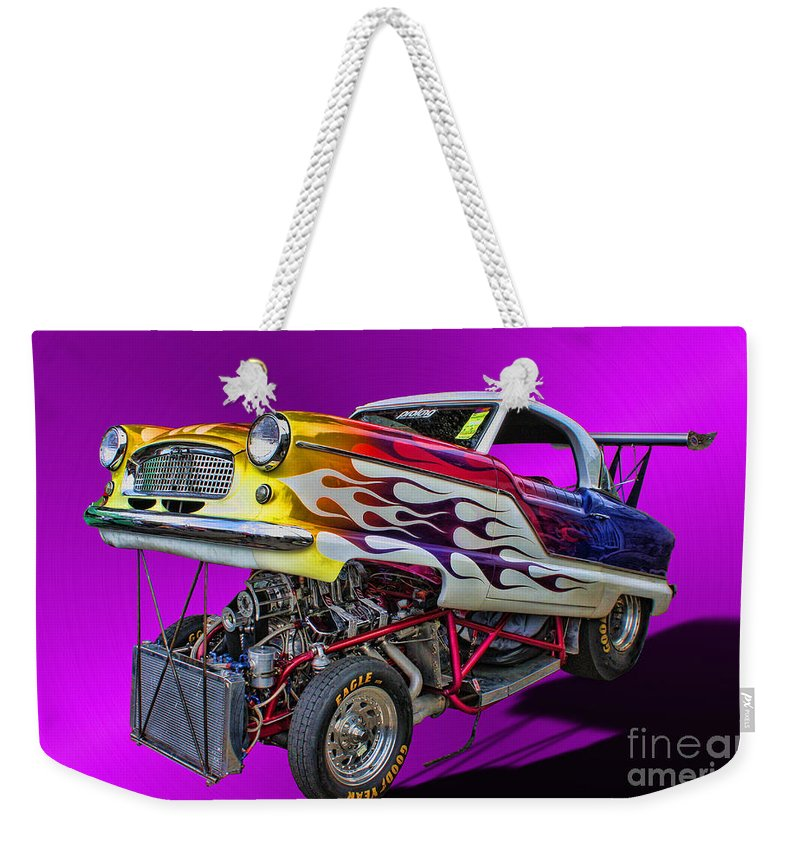 1956 Nash Metropolitan Weekender Tote Bag featuring the photograph Hot Little Nash by Tommy Anderson