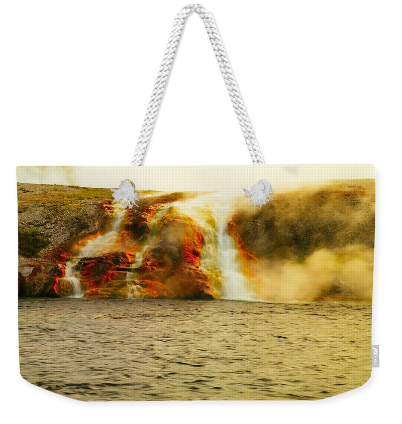 Yellowstone. Geysers. Hot Springs. Volcanic Activity Weekender Tote Bag featuring the photograph Hot Water Pouring by Jeff Swan