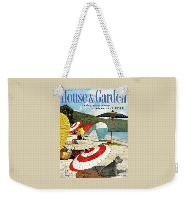 Exterior Weekender Tote Bag featuring the photograph House And Garden Featuring Umbrellas On A Beach by Otto Maya & Jess Brown