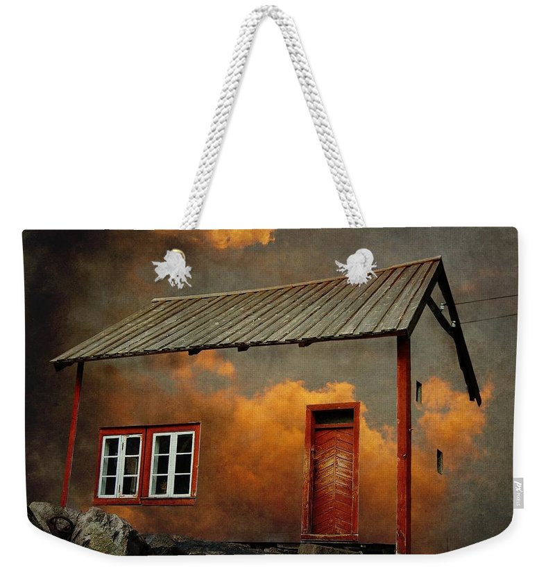 Surrealism Weekender Tote Bag featuring the photograph House in the clouds by Sonya Kanelstrand