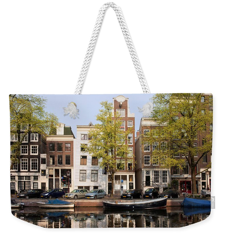 Amsterdam Weekender Tote Bag featuring the photograph Houses In Amsterdam by Artur Bogacki