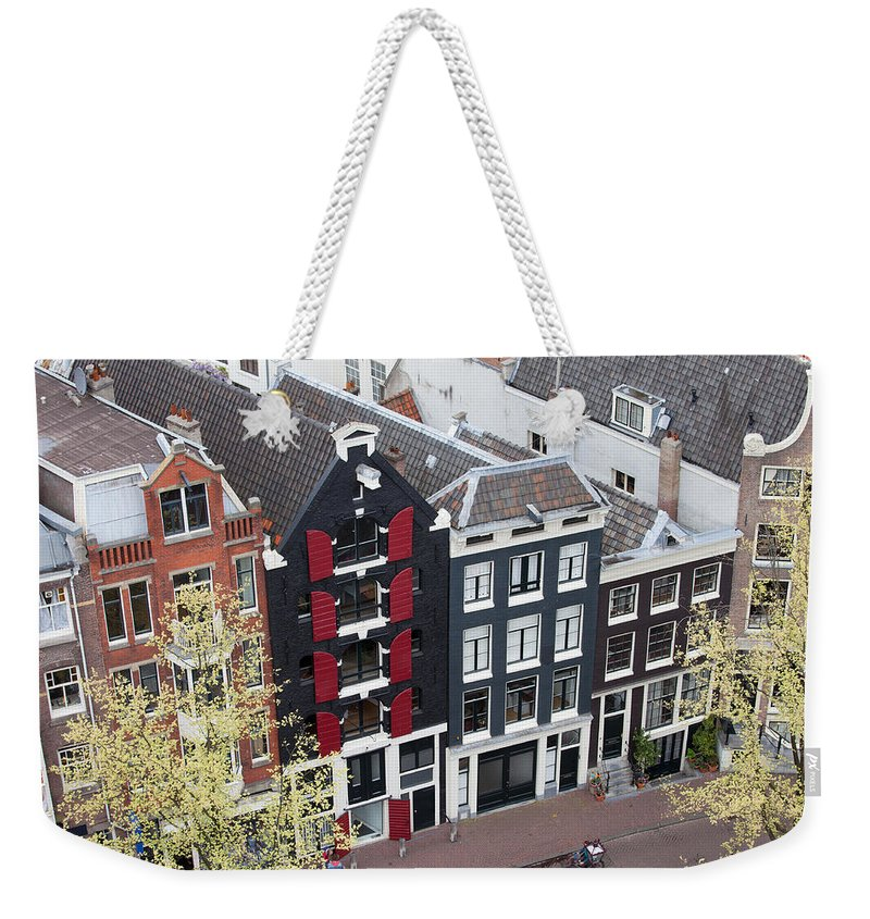 Amsterdam Weekender Tote Bag featuring the photograph Houses In Amsterdam From Above by Artur Bogacki