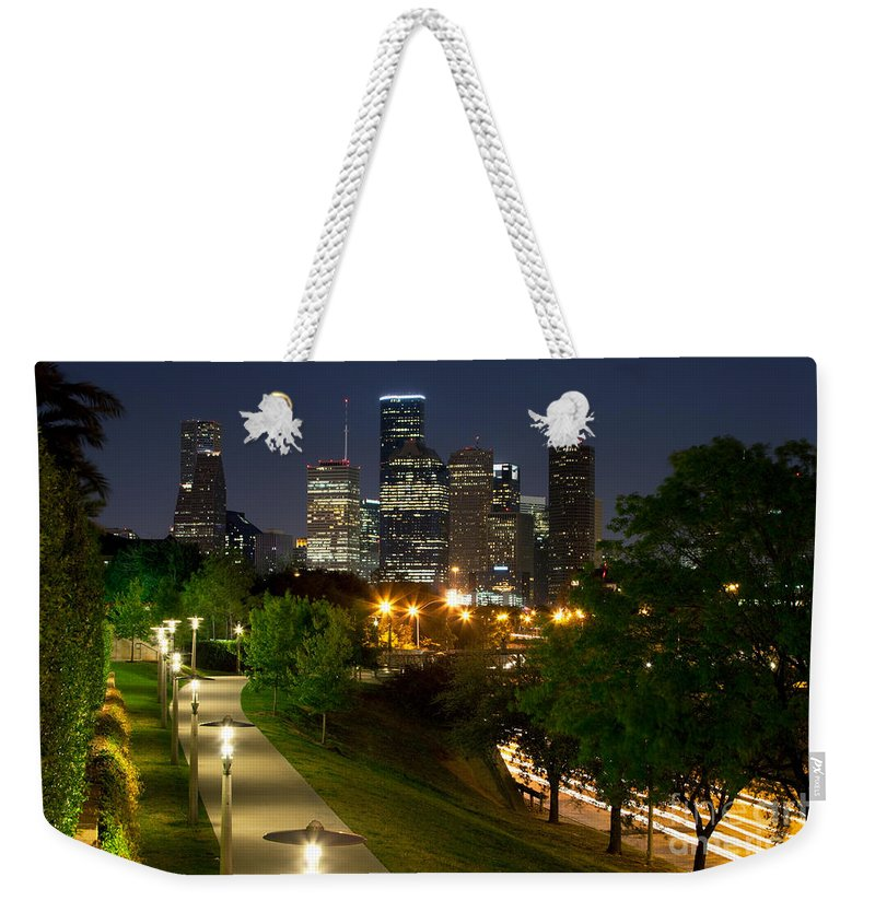 Houston Weekender Tote Bag featuring the photograph Houston At Night by Bill Cobb