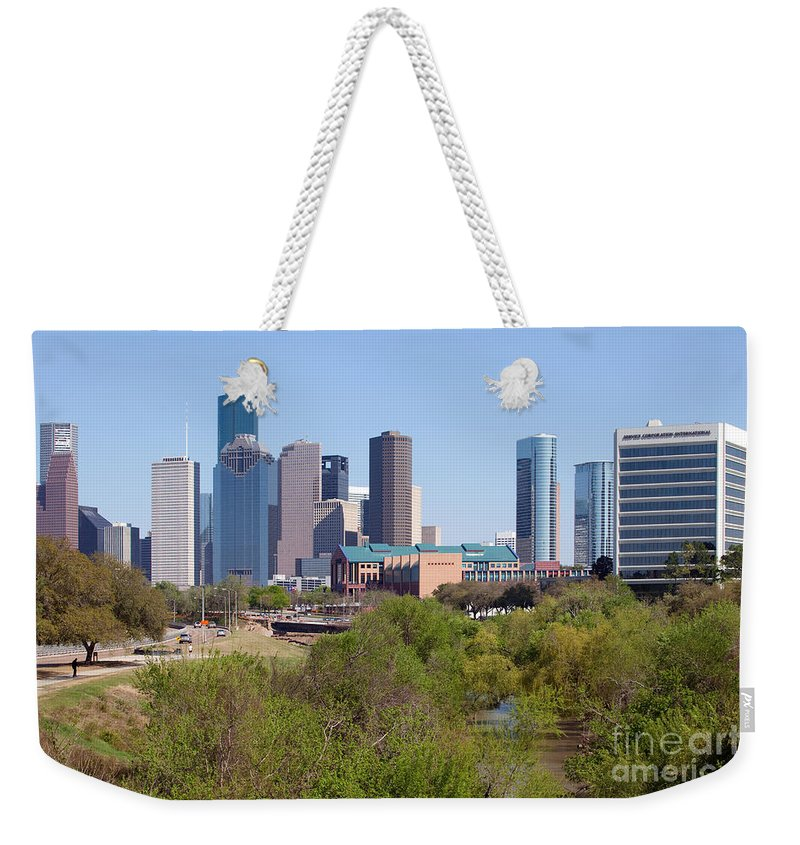 Houston Weekender Tote Bag featuring the photograph Houston Skyline And Buffalo Bayou by Bill Cobb