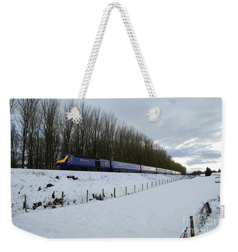 Wellington Weekender Tote Bag featuring the photograph Hst In The Snow by Rob Hawkins