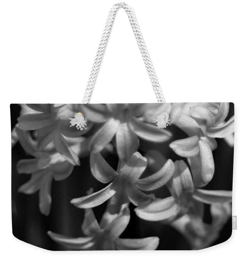 Black And White Hyacinth Weekender Tote Bag featuring the photograph Hyacinth In Black And White by Kitrina Arbuckle