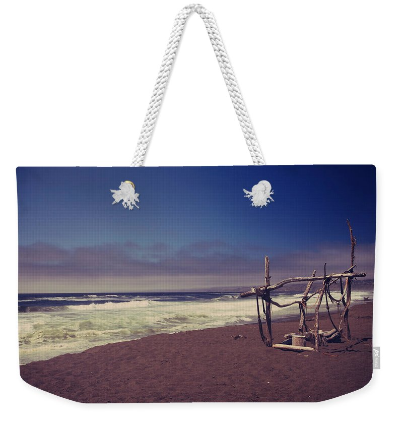 Manchester Beach Weekender Tote Bag featuring the photograph I Feel You Slipping Away by Laurie Search