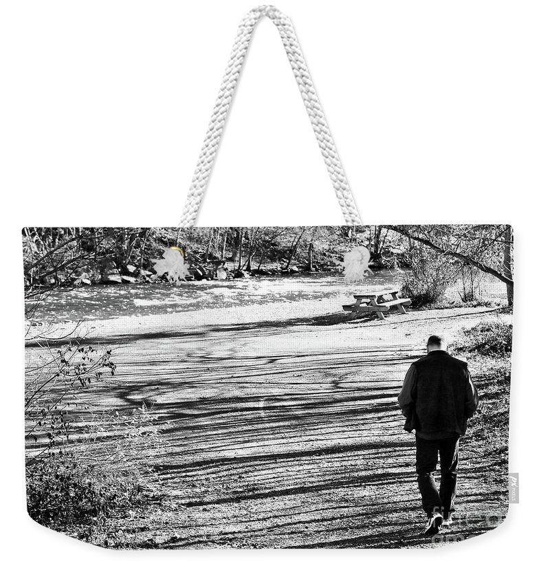 Person Weekender Tote Bag featuring the photograph I Walk Alone by Lori Tambakis