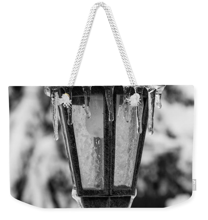 Ice Weekender Tote Bag featuring the photograph Ice Covered Lantern by Photographic Arts And Design Studio