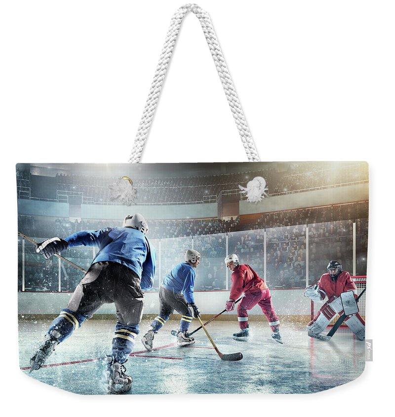 Sports Helmet Weekender Tote Bag featuring the photograph Ice Hockey Players In Action by Dmytro Aksonov