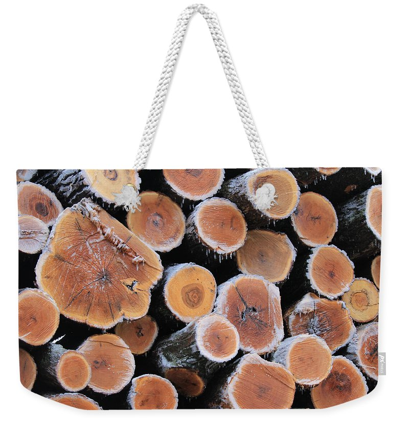 Lumber Weekender Tote Bag featuring the photograph Ice Logs by Carrie Godwin