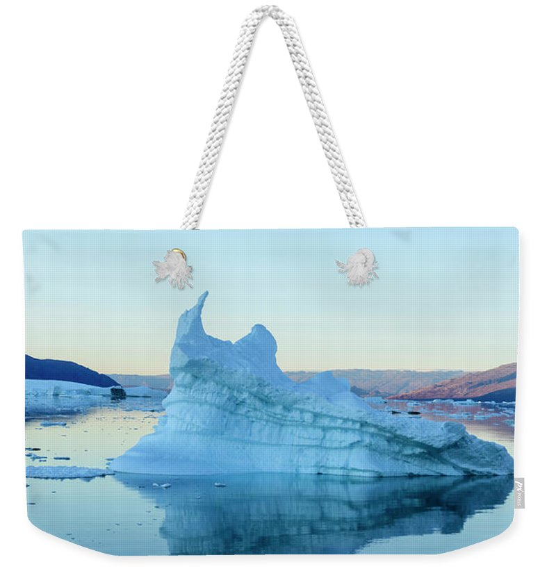 Scenics Weekender Tote Bag featuring the photograph Iceberg In The Scoresby Sund by Berthold Trenkel