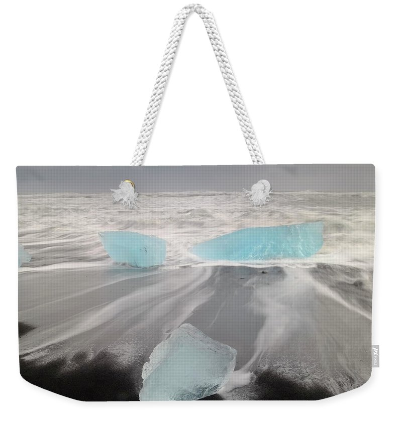 Scenics Weekender Tote Bag featuring the photograph Icebergs Washed Up On Volcanic Sandy by Travelpix Ltd