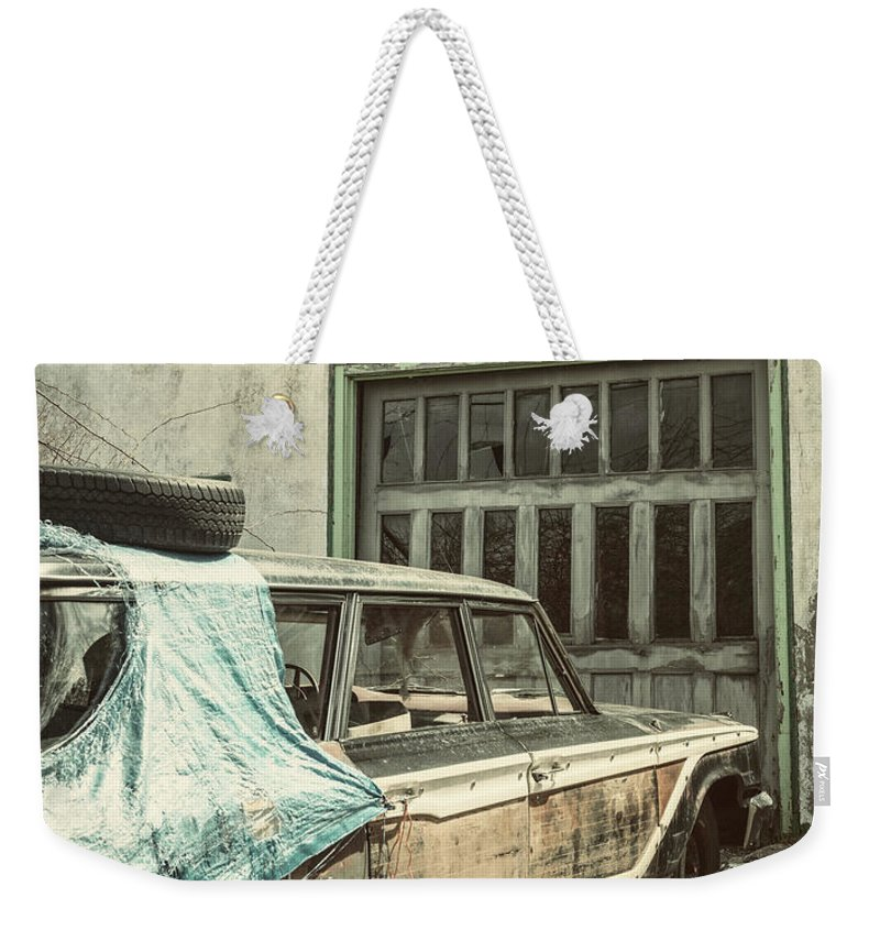 Land Vehicle Weekender Tote Bag featuring the photograph In For Repairs by Shaunl