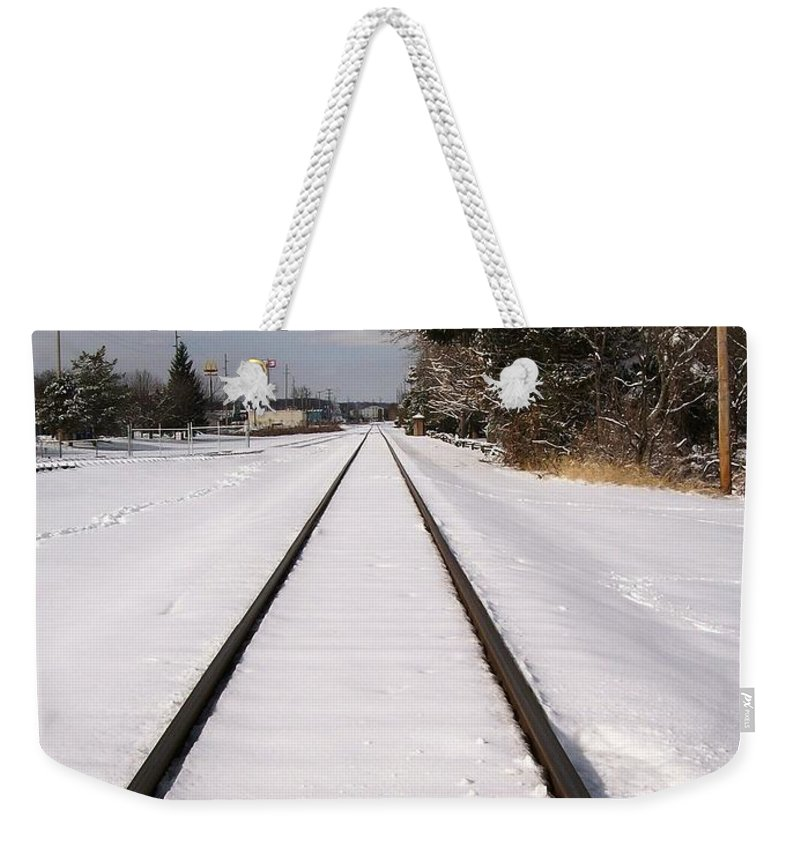 Railroad Weekender Tote Bag featuring the photograph In The Distance by Sara Raber