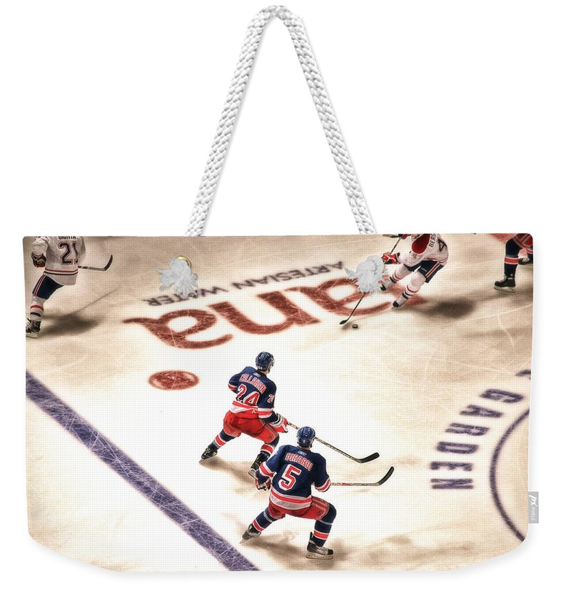 Hockey Weekender Tote Bag featuring the photograph In The Game by Karol Livote