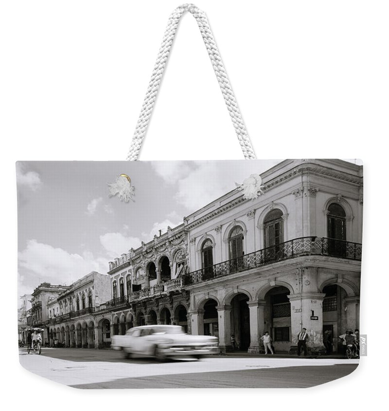 Havana Weekender Tote Bag featuring the photograph The Streets Of Havana by Shaun Higson