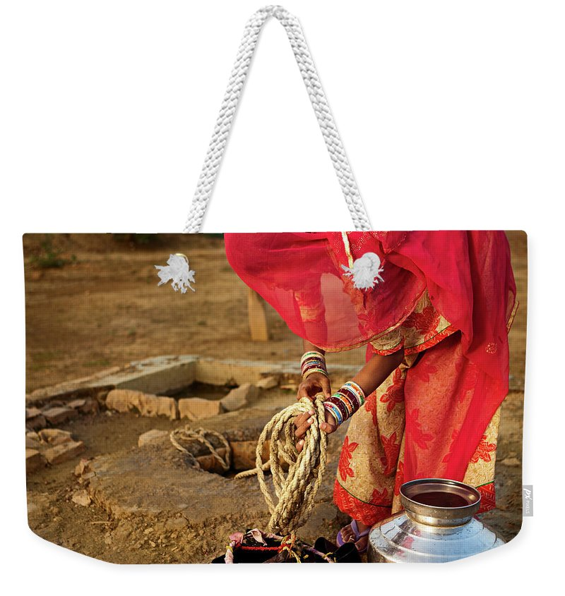 Working Weekender Tote Bag featuring the photograph Indian Woman Getting Water From The by Hadynyah