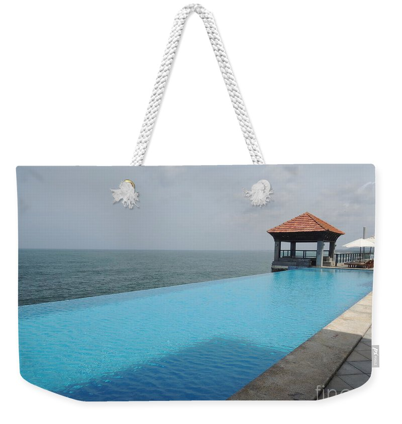 Infinity Pool Weekender Tote Bag Featuring The Photograph At Leela Kovalam By Mini Arora