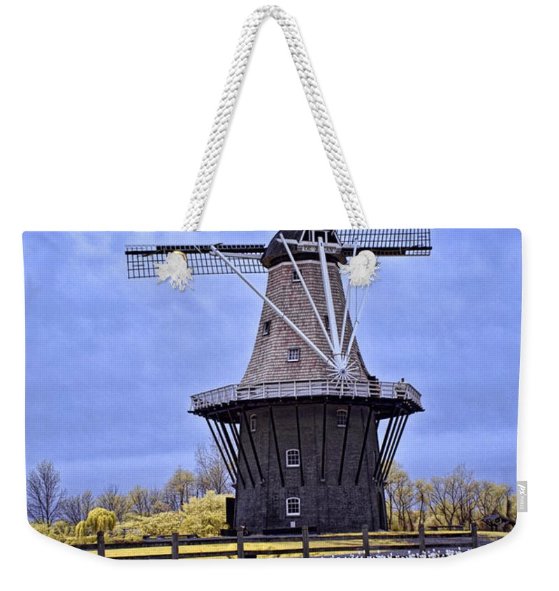Art Weekender Tote Bag featuring the photograph Infrared Photo Of The Dezwaan Dutch Windmill On Windmill Island In Holland Michigan by Randall Nyhof