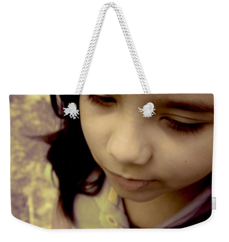 Innocent Weekender Tote Bag featuring the photograph Innocence by Paulo Guimaraes